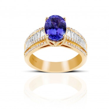 Oval Solitaire Tanzanite Cocktail ring with Baguette Diamond accents 14 Karat Yellow Gold