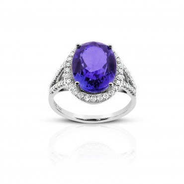 Cocktail style Oval Tanzanite halo ring with Pave' Diamond accents 14 Karat White Gold