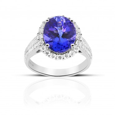 Cocktail style Oval Tanzanite Diamond halo ring with Pave' Diamond accents 14 Karat White Gold